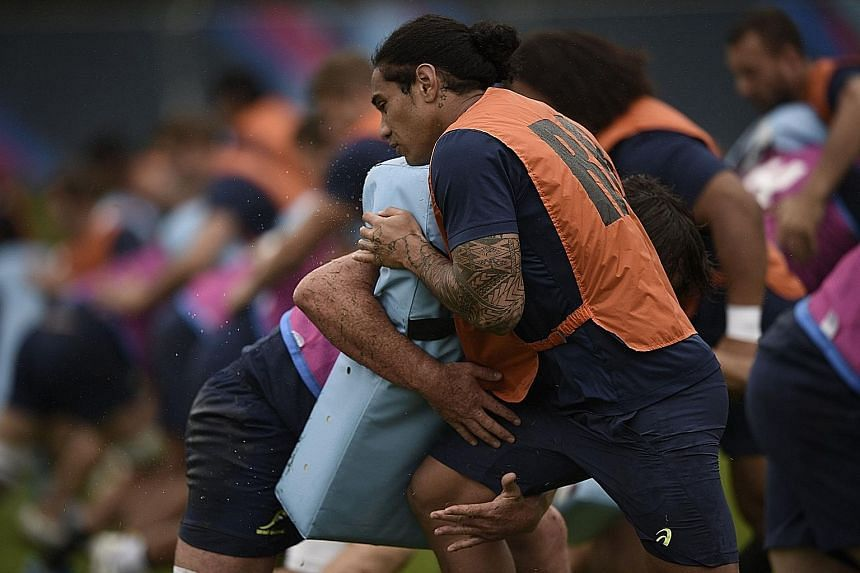Australia's wing Joe Tomane training before facing Fiji. The Wallabies insist the tough Pool A will keep them on their toes.