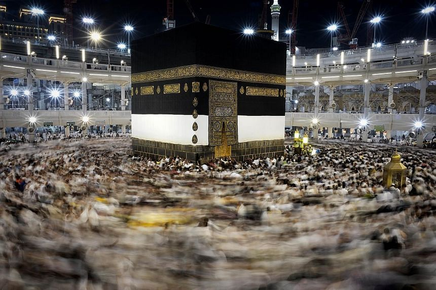 Muslim pilgrims circling counterclockwise Islam's holiest shrine, the Kaaba, at the Grand Mosque in the Saudi holy city of Mecca, late on Monday.