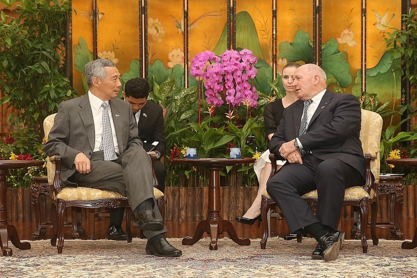 Prime Minister Lee Hsien Loong (far left) and Governor- General Peter Cosgrove reaffirmed bilateral ties between Singapore and Australia.