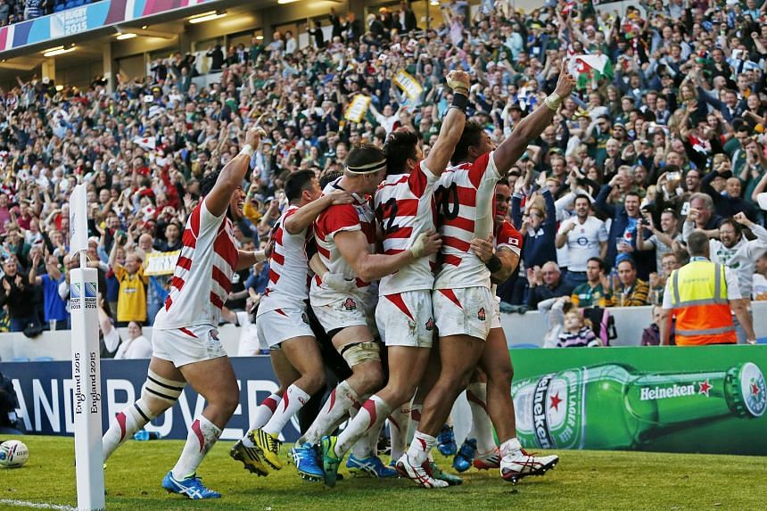 Japan's Rugby team celebrating after defeating South Africa 34-32.