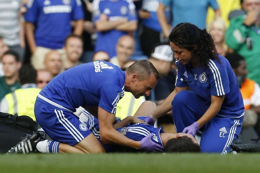 Chelsea doctor Eva Carneiro (right) and head physio Jon Fearn (left) treating Chelsea's Eden Hazard in August 2015.