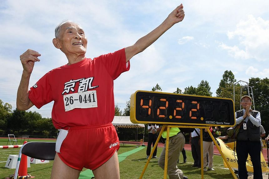 Hidekichi Miyazaki (in red), 105, imitates the pose of Usain Bolt after running with other competitors over eighty years of age during a 100-metre-dash in the Kyoto Masters Autumn Competiton in Kyoto, western Japan, on Sept 23, 2015.