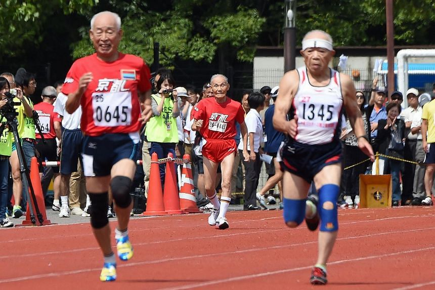 Hidekichi Miyazaki (back centre), 105, runs with other competitors over eighty years of age during a 100-metre-dash in the Kyoto Masters Autumn Competiton in Kyoto, western Japan, on Sept 23, 2015.