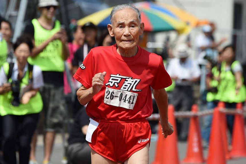 Hidekichi Miyazaki, 105, runs with other competitors over eighty years of age during a 100-metre-dash in the Kyoto Masters Autumn Competiton in Kyoto, western Japan, on Sept 23, 2015.