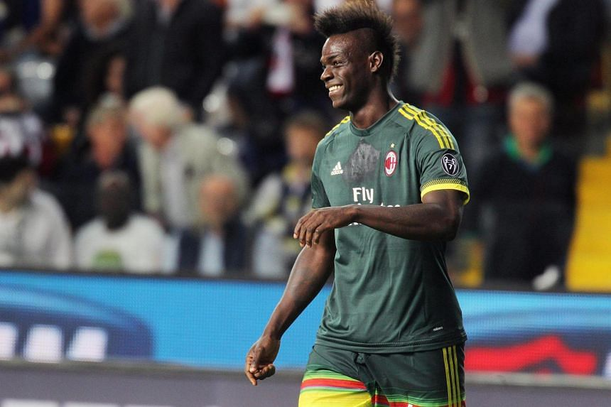 AC Milan's Mario Balotelli celebrates after scoring the opening goal during the match against Udinese on Sept 22, 2015.