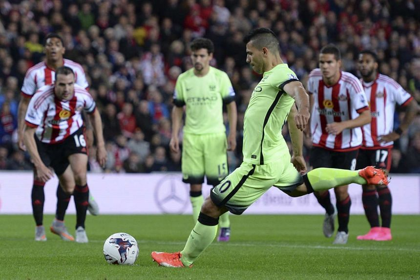 Manchester City striker Sergio Aguero scores the opening goal from the penalty spot.
