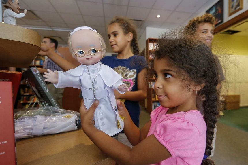 Ryland Day, 4, of Tallahassee, Florida, looks at a Pope Francis doll at the Catholic Information Center & Bookstore in Washington DC just before his arrival in the United States for a five-day visit.