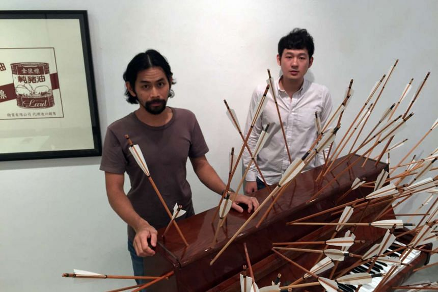 Vertical Submarine's Joshua Yang (above left) and Justin Loke (right) with their mixed media piano installation, Play The Piano Drunk Like A Percussion Instrument Until The Middle Finger Begins To Bleed A Bit.