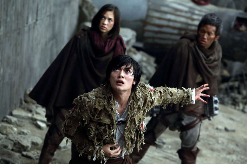 Kiko Mizuhara (left) and Haruma Miura (centre) continue their fight against human-eating creatures in Attack On  Titan 2: End Of The World.