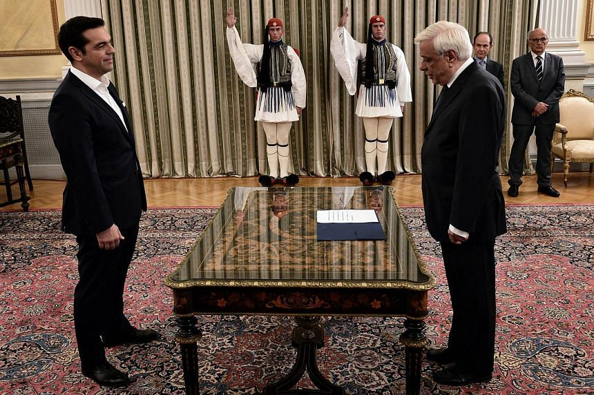 Greek Prime Minister Alexis Tsipras (left) attends the oath-taking ceremony with Greece's President Prokopis Pavlopoulos in Athens on Sept 21, 2015.