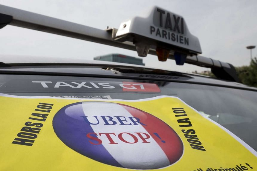 A file photo shows taxis blocking an area of Paris in protest at competition from Uber.