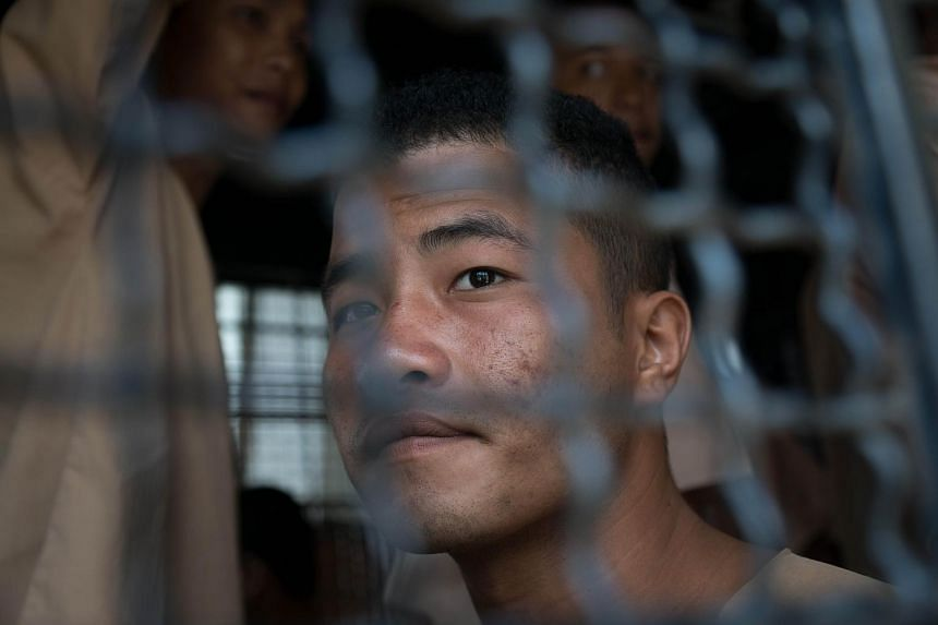 Myanmar national Zaw Lin looks on as he arrives in a prison transport van outside Koh Samui court in this July 9, 2015 file photo.