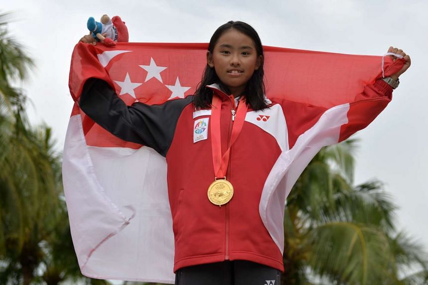 Singapore's Jodie Lai with her gold medal after winning the female Optimist category at the 28th Sea Games held at the National Sailing Centre on Jun 13, 2015.