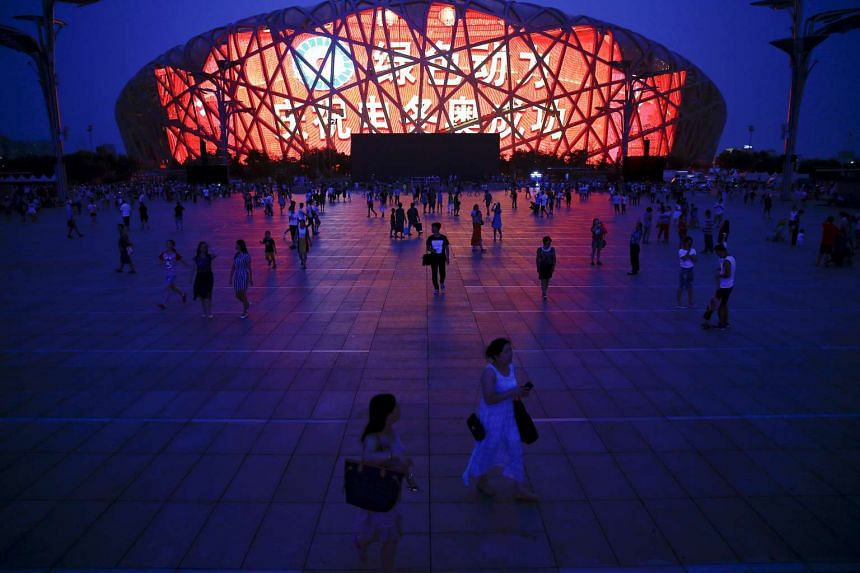 A message of congratulation is projected onto the Bird's Nest Olympic stadium as people gather after Beijing was chosen to host the 2022 Winter Olympics in Beijing Jul 31, 2015.