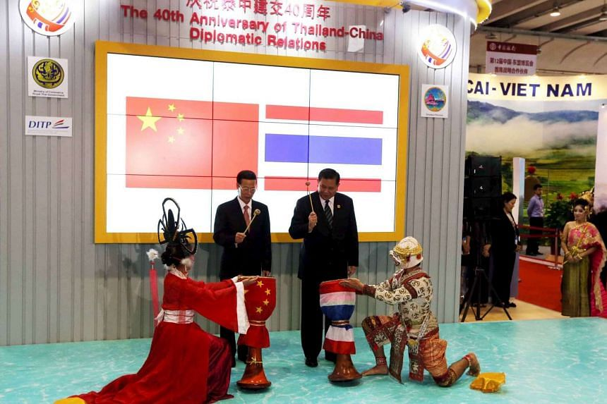 China's Vice Premier Zhang Gaoli (left) and Thailand's Deputy Prime Minister and Foreign Minister General Tanasak Patimapragorn (right) attend the opening ceremony of the Thai exhibition hall during the China-ASEAN Expo in Nanning, Guangxi Zhuang Aut