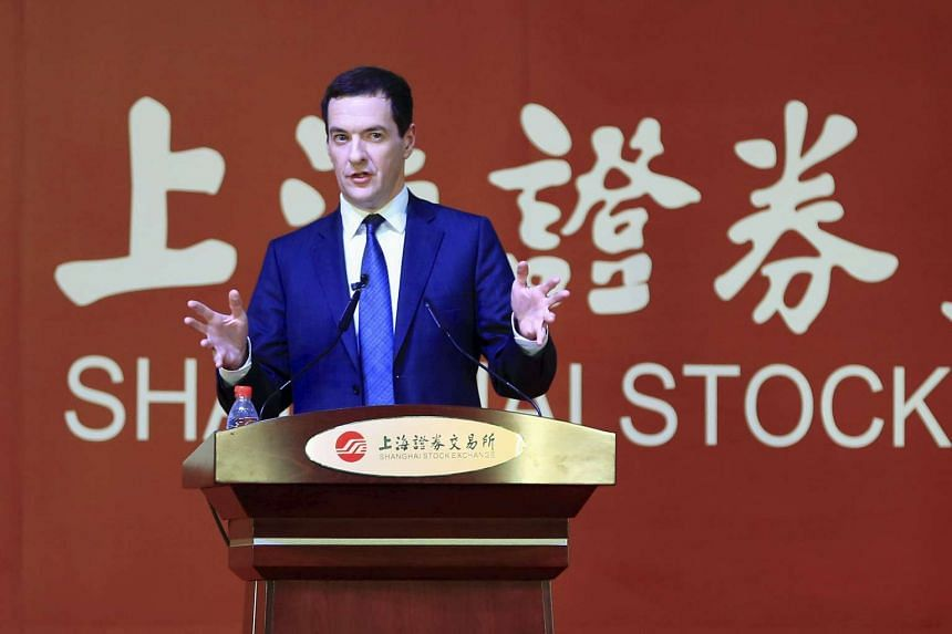 Britain's Chancellor of the Exchequer George Osborne delivers a speech at the Shanghai Stock Exchange in Shanghai, China, on Sept 22, 2015. Mr Osborne announced a feasibility study into linking the London and Shanghai stock exchanges earlier in his t