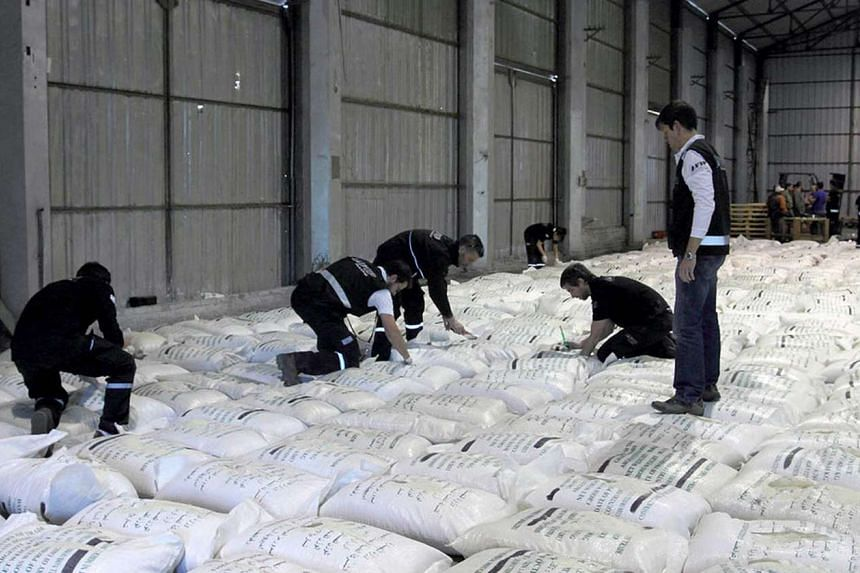 A photo released by Telam of officers arranging 920 bags of seized special rice fused with some 20kg to 30kg of liquid cocaine in Buenos Aires on Sept 23, 2015. Creative drug smugglers in Rosario, Argentina fused rice with cocaine and tried to ship n