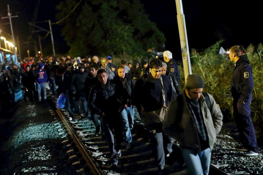 Migrants disembark from a train after arriving at the station in Botovo, Croatia Sept 23, 2015, before walking to the Hungarian border.