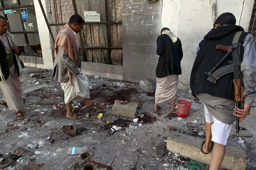 Yemeni Huthi rebels checking the Balili mosque in the capital Sanaa, following an explosion on Sept 24, 2015 on the first day of Eid al-Adha, the Feast of the Sacrifice, the most important holiday of the Islamic calendar. A suicide bomber struck a mo