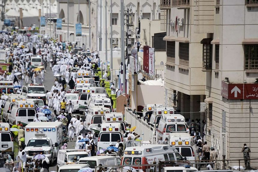 Saudi ambulances arrive with pilgrims who were injured in a stampede at an emergency hospital in Mina on Sept 24, 2015.