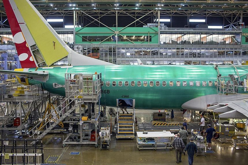 Workers assembling a Boeing 737 aeroplane at the company's factory in Renton, Washington. Boeing has signed a cooperation document to build an aircraft completion centre in China, Xinhua reported.
