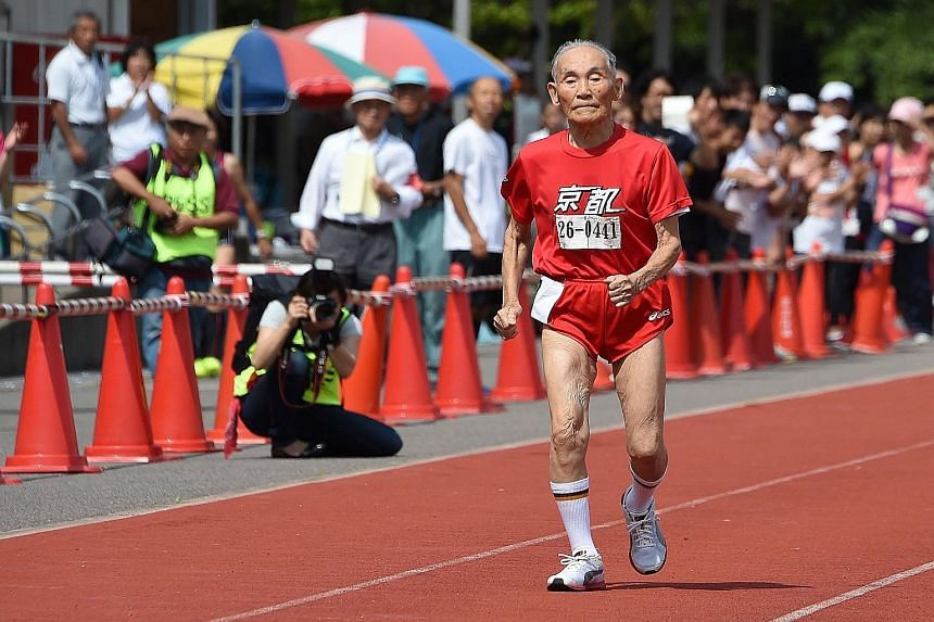 """Mr Hidekichi Miyazaki getting off to a wobbly start before finding a gentle rhythm. After the race (right), the 105-year-old """"Golden Bolt"""" said he would like to race against sprint king Usain Bolt."""