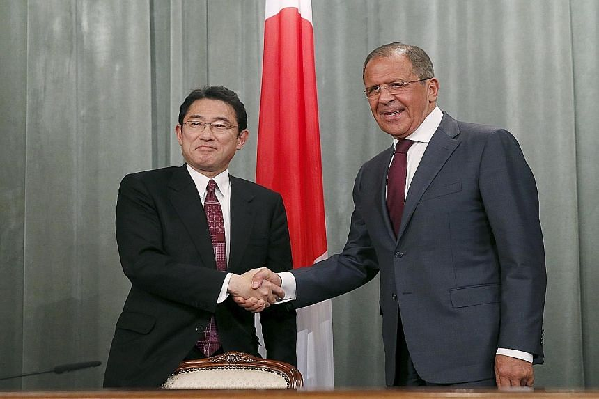 Russian Foreign Minister Sergei Lavrov (at right) and his Japanese counterpart Fumio Kishida after their joint news conference in Moscow.