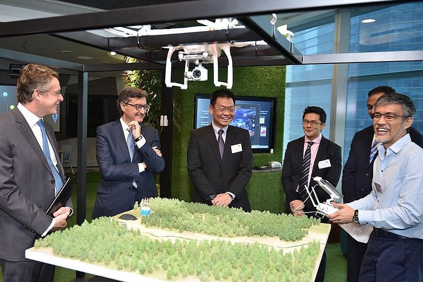 Accenture's Mr Gianfranco Casati (second from left) and EDB managing director Yeoh Keat Chuan (third from left) hope to see the centre help firms create new innovations with IoT technologies.