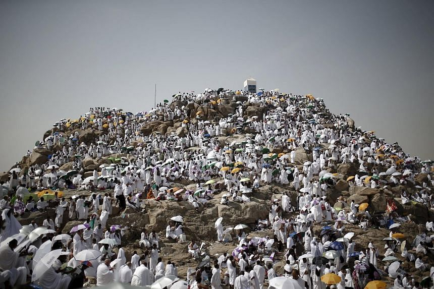 Muslim pilgrims at Mount Mercy on the plains of Arafat, where millions gathered during the annual haj pilgrimage, outside the holy city of Mecca yesterday. Many were praying for peace in the Middle East countries ravaged by war and chaos, as the annu