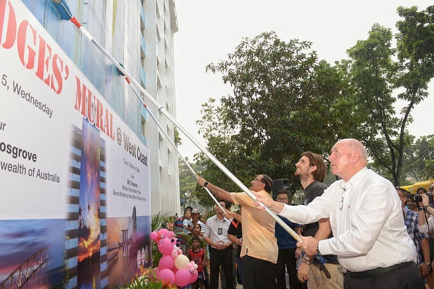 The Australian Governor-General, Sir Peter Cosgrove (right), and Singapore's Second Minister for Trade and Industry S. Iswaran putting the finishing touches to a mural at Block 728, Clementi West Street 2, It was painted by 31-year-old professional s