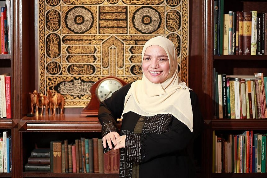 Dr Sharifah Mariam Aljunied, 47, at home in Pasir Ris. She is a descendant of Singapore's first Arab resident Syed Omar Ali Aljunied, who built Singapore's first mosque in 1820 - the Masjid Omar Kampong Melaka in Keng Cheow Street. He also gave Raffl