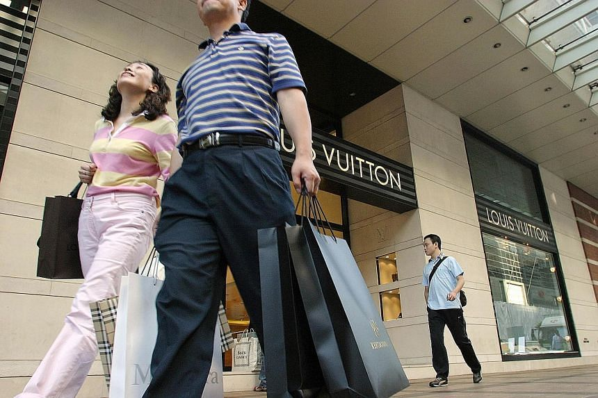 """Chinese tourists outside luxury goods stores in Hong Kong. Luxury sales have been falling in Hong Kong because many Chinese spenders are now heading to more """"fashionable"""" destinations such as Japan, South Korea and Taiwan, says HSBC Global's co-head"""