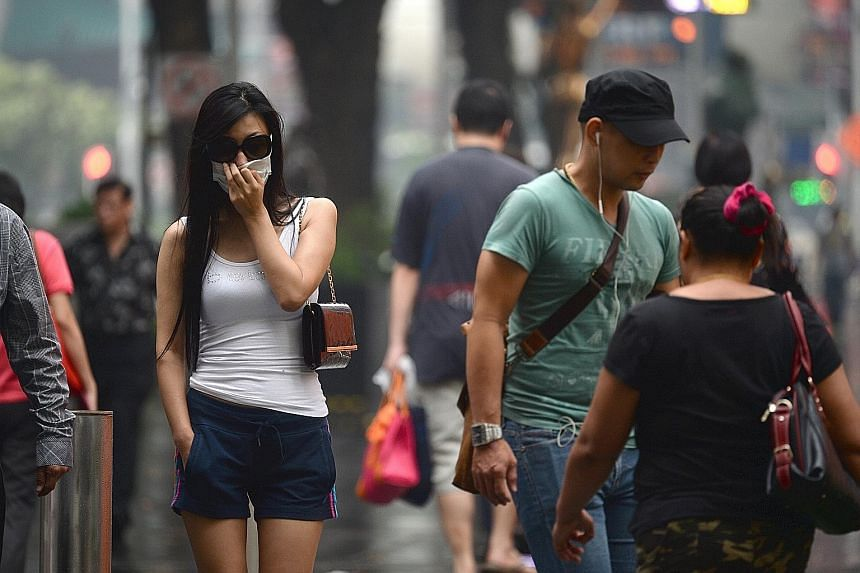 Orchard Road during the haze last week. Experts say one of the best ways to determine how unhealthy the air is in real time is to look at the one-hour PM2.5 levels published by NEA,