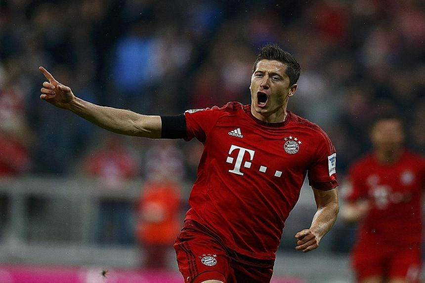 Lewandowski (left) scoring his first goal. His five goals against Wolfsburg came from nine shots and 30 touches.