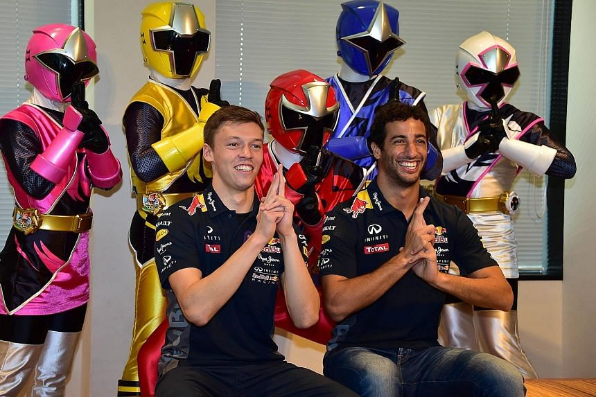Red Bull drivers Daniil Kvyat (left) and Daniel Ricciardo posing with television ninja hero characters during a promotional event for Japan's Mie prefecture in Tokyo yesterday. The Japanese GP, held at Suzuka in the prefecture, will be a chance for M