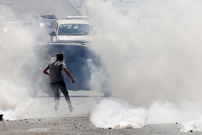 Israeli troops firing tear gas at Palestinian protesters during clashes in the West Bank city of Bethlehem on Monday. Tensions were running high as people in the region prepared to celebrate Yom Kippur and Eid al-Adha.
