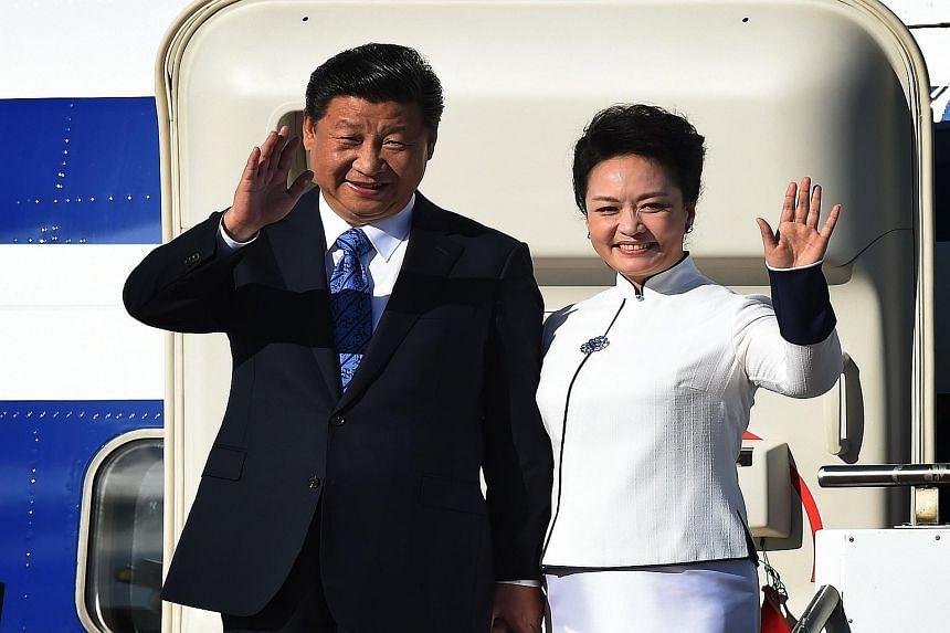 Chinese President Xi Jinping and his wife Peng Liyuan arriving in Seattle, Washington, on Tuesday, where he spoke to dignitaries and business leaders. Mr Xi put into context China's development over the last few decades and laid out how the country s