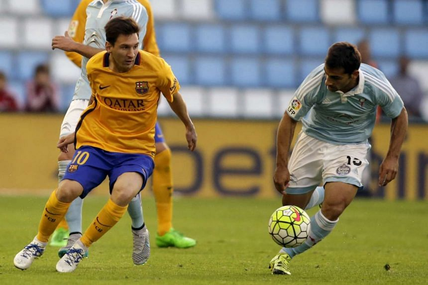 Celta Vigo's defender Jonny Castro (right) fights for the ball with Barcelona's Argentinian forward Lionel Messi.