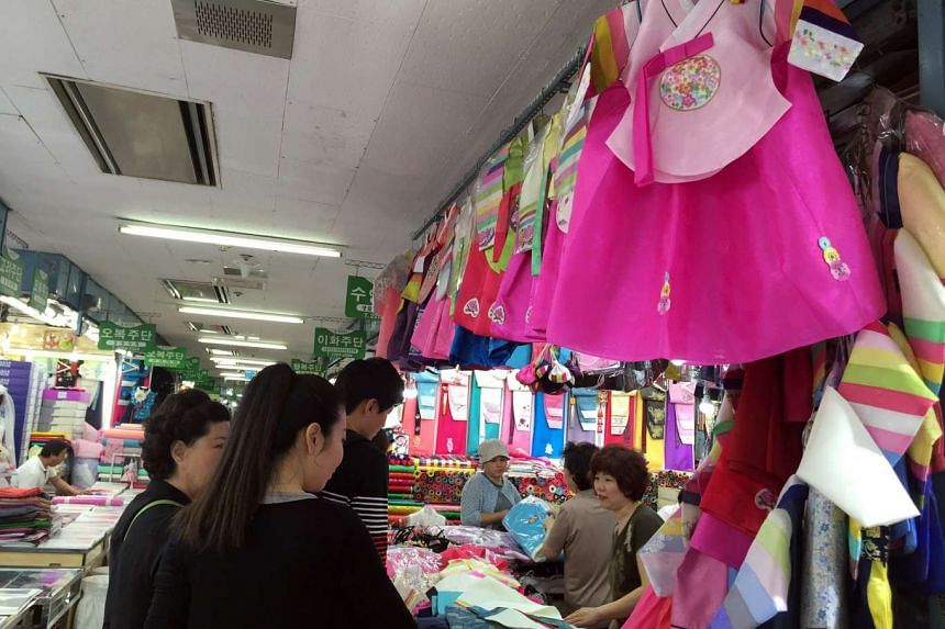 Women checking out hanboks (Korean traditional dress) for children at a shop in Dongdaemun Shopping Complex, ahead of the Chuseok festival, or Korean Thanksgiving Day.