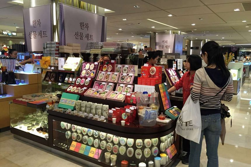 Women shopping for gift sets at a department store in Seoul, ahead of the Chuseok festival, or Korean Thanksgiving Day.