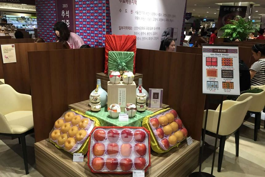 Fruit baskets on display at sales counters at a department store that are set up specially to take delivery orders for the upcoming Chuseok festival, or Korean Thanksgiving Day.