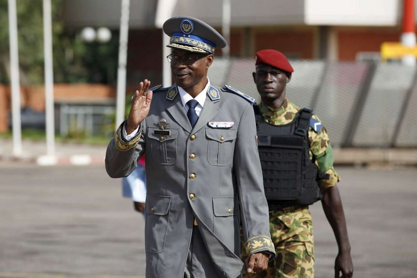 Burkina Faso's coup leader General Gilbert Diendere arrives at the airport to greet foreign heads of state in Ouagadougou.