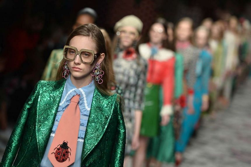 Models present creations for fashion house Gucci for Spring/Summer 2016 at Milan Fashion Week.