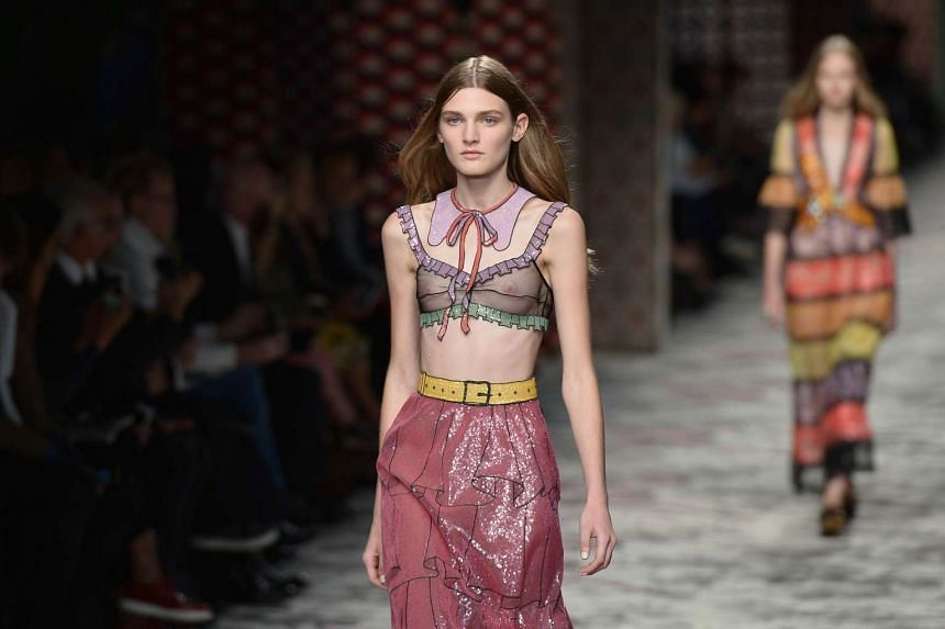 A model presents a creation for fashion house Gucci.