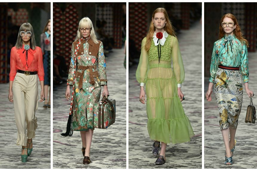 Models present creations for fashion house Gucci.