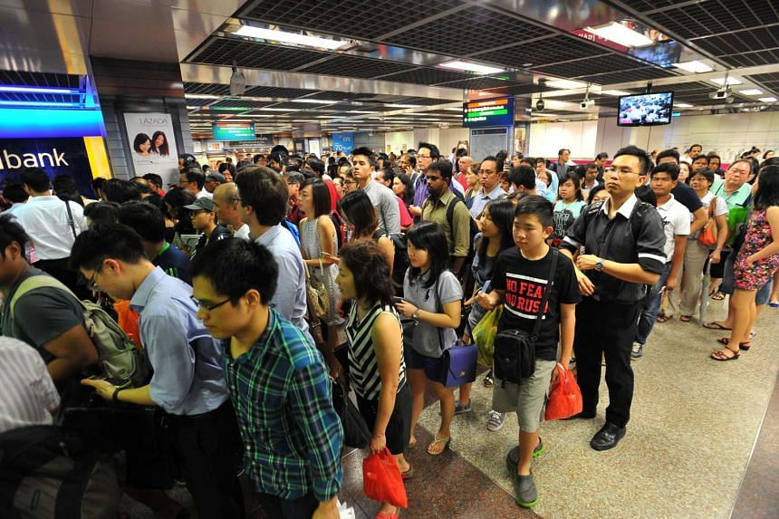 The crowd at City Hall MRT station during the service disruption on July 7, 2015.