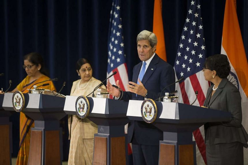 Mr John Kerry with (from left) Indian Minister of State for Commerce and Industry Nirmala Sitharaman, Indian Minister of External Affairs Sushma Swaraj, and US Secretary of Commerce Penny Pritzker during a news conference at the State Department in W