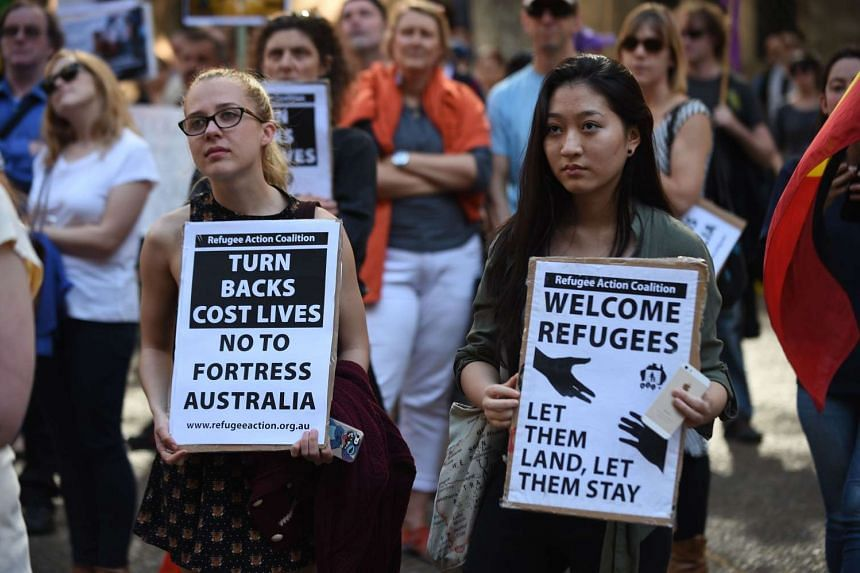 Protesters rallying in Sydney earlier this month against Australia's policy of turning back boats and sending those it cannot for detention at offshore camps. Polls, however, show that a strong majority of Australians supported it.