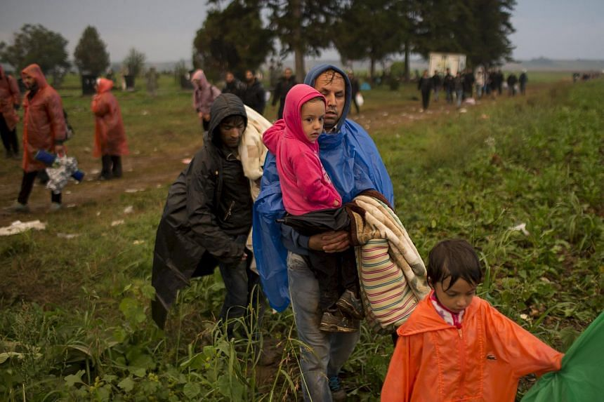 Migrants on a field near Tovarnik, Croatia, after they crossed Serbian border, on Sept 24, 2015.