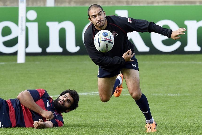 Georgia's scrum half Giorgi Begadze passes the ball during a training session on the eve of the Rugby World Cup 2015 Pool C match against Argentina